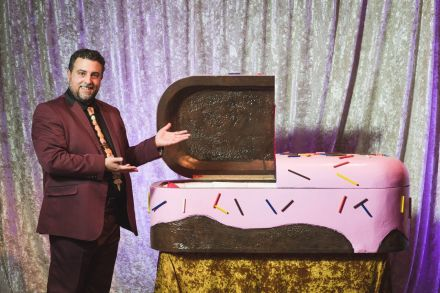 Actor Matthew Korahais presents a children's sugar coffin, courtesy Will Star Shooting Stars for Creative Time