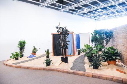 Hélio Oiticica, Tropicália (Installation view) (1966-67) Plants, sand, birds, poems by Roberta Camila Salgado on bricks, tiles and vinyl squares. Collection of César and Claudio Oiticica. Photograph by Matt Casarella
